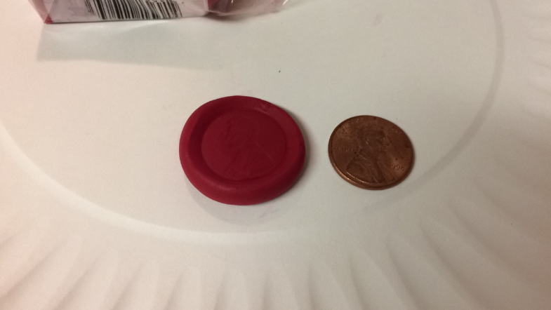 Take you red polymer clay and roll it into a ball.
